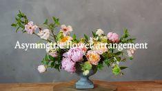 Asymmetric flower arrangement - YouTube Ranunculus, Peonies, Diy Design, Floral Design, Floral Arrangements, Flower Arrangement, Christmas Rose, Mechanical Design, Delphinium
