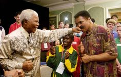 South Africa's President Nelson Mandela lands a playful punch on the chin of former World Champion boxer Muhammad Ali in Dublin, Republic of Ireland, June Mandela and Ali were in Dublin to attend the 2003 Special Olympics World Summer Games Muhammad Ali, Nelson Mandela, Sports Illustrated, Kentucky, I Love Being Black, Float Like A Butterfly, Special Olympics, Sports Figures, African American History