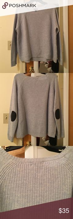 J Crew wool sweater with leather arm pads 100% wool knit sweater with 100% leather arm pads on the elbows. In good condition. THe color is a light blue J. Crew Sweaters Crew & Scoop Necks