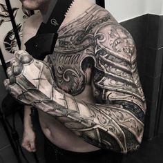 61 Best Stylish, Beautiful and Unique Tattoos for Men unique tattoos for men; unique tattoos for couples; unique tattoos for my son; unique tattoos for lost loved ones; unique tattoos for parents; unique tattoos for best friends Armor Sleeve Tattoo, Armour Tattoo, Shoulder Armor Tattoo, Full Sleeve Tattoos, Tattoo Sleeve Designs, Tattoo Designs Men, Shoulder Sleeve, Man Sleeve Tattoo Ideas, Back Tattoo Men