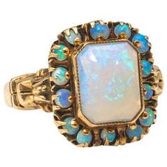 Victorian era yellow gold ring with 8 x cushion shaped opal surrounded by 14 small round opals. Flashes of blues and greens reside inside this ethereal Australian fire opal. Opal Jewelry, Sea Glass Jewelry, Jewelry Box, Jewelry Rings, Fine Jewelry, Bullet Jewelry, Jewelry Ideas, Antique Rings, Vintage Rings