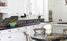Glass Mosaic Backsplash Black Granite.  I like the contrast between the dark backsplash and white cabinets here.