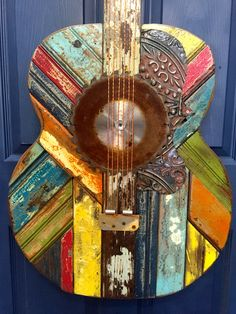Celebrate your love of all things acoustic with this Gibson Vintage Guitar wall sculpture. It is handcrafted in the Southeast US with reclaimed wood and found objects. The piece is shown in the under the sun colorway. Diy Wall Art, Wood Wall Art, Acoustic Wall, Acoustic Guitars, Guitar Wall Art, Guitar Painting, Music Wall, Diy Furniture Projects, Wood Projects