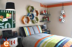 A room a young boy who loves sports can grow into.  Love the football bulletin board, ball chain, and hexagon shelves.