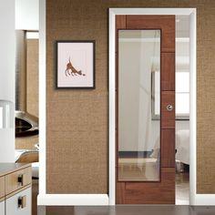 Single Pocket Ravenna Walnut Flush Door with Clear Glass, Prefinished. #wlanutpocketdoors #modernpocketdoors #slidingdoors