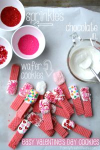 Do you need an Easy Valentine's Day Cookies to make this February? Fun for the kids to make and eat! All you need are some chocolate, sprinkles and wafers!