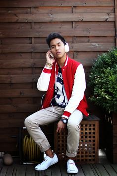 Casual cool in red varsity jacket