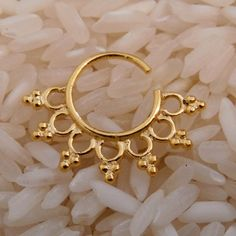 Gold Plated Septum For Pierced Nose - Body Jewelry - Septum Jewelry - Indian Nose Ring - Ethnic Septum - Septum Piercing - Nose Jewelry  This unique septum is made of gold plated brass and decorated with small brass balls.   For pierced nose. Can be worn on the ear as well.  The bar is 1mm. 18 Gauge. Inner Diameter: 10mm Total diameter: 16mm.  Available also in silver. $16