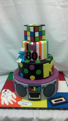 80's cake! I love the rubic cube bottom.