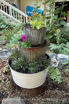 stack old buckets in the garden for a unique planter. I have some old buckets and a wash tin that would be perfect Flower Tower, Pot Jardin, Barrel Planter, Garden Planters, Dream Garden, Lawn And Garden, Garden Projects, Amazing Gardens, Garden Inspiration