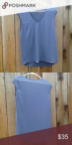 J. Crew Sleeveless High Low Grey Top Size 4 J. Crew Sleeveless High Low Grey Top Size 4  100% polyester Excellent pre-owned condition No stains or flaws  Comfortable and perfect dressed up or down! Looks great with beige or black pants! J. Crew Tops Tunics