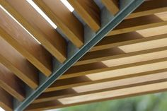 This detail shows the simplicity of the design: tightly spaced wood slats connected to paired galvanized steel angles.