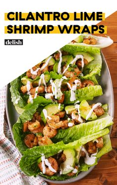 Cilantro Lime Shrimp Wraps are like low-carb tacos. Get the recipe at Delish.com. #recipe #easy #easyrecipes #shrimp #seafood #lowcarb #dinner #easydinner #dinnerrecipes #avocado Shrimp Lettuce Wraps, Lettuce Wrap Recipes, Cilantro Lime Shrimp, Low Carb Tacos, Avocado, Easy Meals, Seafood, Dinner Recipes, Delish