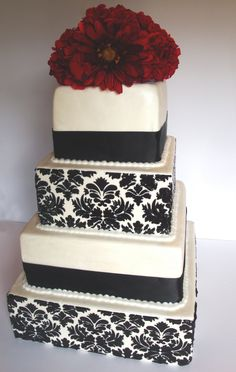 Black and White Damask Wedding Cake (except I'd want purple flowers on mine)