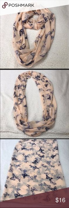 Infinity Scarf Peach with Blue Butterflies. ed1 This is a gently used butterfly Infinite scarf. It is a peach color with blue butterflies. It is 100% polyester. There are no stains, no rips, no snags, no tears, no holes.  (ed1) Studio S Accessories Scarves & Wraps