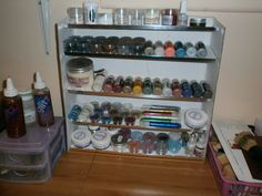 I made this unit to house my glitters and embossing powders,so that I can see at a glance what I've got.I used cardboard for the main part and some left-over tile edging.