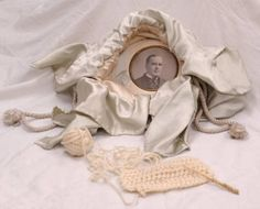 Ida Saxton McKinley used this silk bag to hold the yarn and needles she used to crocheted an estimated 4,000 pairs of bedroom slippers. She distributed them to friends, veterans, and orphans or sold them at auction to raise money for charity. Inside is a photograph of her husband, William McKinley (1843-1901). It was most likely taken in the 1880s, while he was serving in the U.S. House of Representatives.  This bag is on display at the McKinley Presidential Library & Museum.