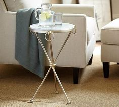 This could be really cute between the 2 chairs if you go with the worlds away coffee table. Leila Marble-Top Side Table #potterybarn