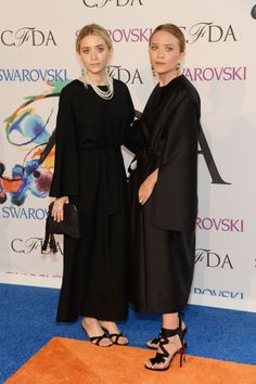 See All the Red Carpet Looks From the 2014 CFDA Awards Ashley Olsen and Mary-Kate Olsen wore vintage black dresses and simple sandals.