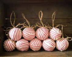 I used a beautiful red and cream cotton ticking fabric to make these ragballs built on hollow mache ball cores. The stripes, raw edges, and natural jute twine blend together just perfectly. It's like candy!