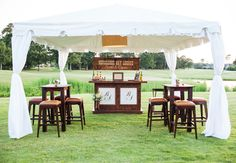 Rustic-chic bar // Theo Milo Photography // http://blog.theknot.com/2013/10/28/a-rustic-meets-regal-wedding-with-cowboy-boot-decor/