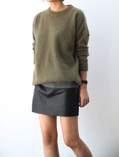 Green cashmere sweater and leather mini