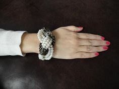 Chic Knotted Twist DIY Bracelet: This knockoff bracelet combines pearls and chains to create a stunning (and thrifty) jewelry design.