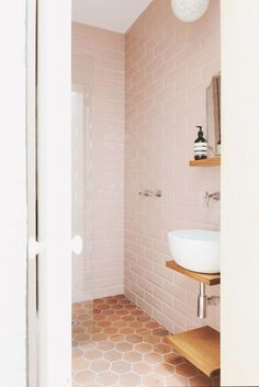 """These modern (& sophisticated) bathrooms prove that """"Millennial Pink"""" isn't going anywhere anytime soon."""