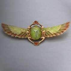 Art Nouveau - Egyptian Revival Scarab Brooch -  Plique a Jour Enameled Silver. Circa 1900. 60mm x 22.5mm x 9mm.