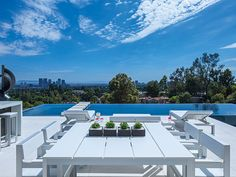 Laurel Way Residence: Outdoor entertainment area with zero edge infinity pool and impressive views