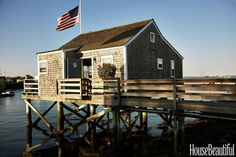 NANTUCKET BOATHOUSE-- Designer Gary McBournie decorated a wharf cottage that's akin to living on a boat. When all of the windows are open to the salty breeze, you'll feel ready to set sail on the open ocean.
