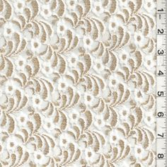 White Chantilly Lace     Item#: 6191      Solid White  Chantilly Lace Fabric with Gold Metallic Embroidery  Suitable for Apparel, Home Decor & Special Occasion