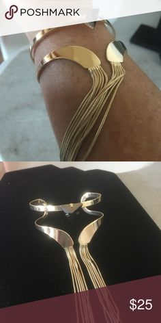 REDUCED! Gold Plated Cuff Bracelet with Fringe A beautiful gold cuff bracelet with hanging gold fringe. Reminds me of the days of Cleopatra! A gorgeous piece and definitely one of a kind! Jewelry Bracelets
