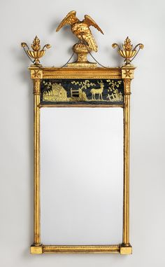 Looking glass, 1800–1820, New York City, Gilt gesso, pine, wire, églomisé tablet. This early nineteenth-century looking glass from New York City is surmounted by a bald eagle. The work is characterized by the Neoclassical style popular at the time, with the eagle serving as a appropriate symbol from both antiquity and Federal America.