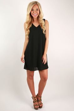 """If you're still looking for the perfect little black dress, look no further than the """"Paris Chic Dress!"""" The shift style is super flattering and comfortable for warm and sunny days! Pair it with classy heels and pearls for a timeless look for date night or with tall wedges and bold jewelry for a night out with the girls! It's so versatile, you'll find yourself reaching for it all the time! Features a full lining."""