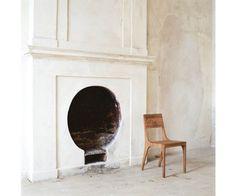 Circular, round fireplace, minimal interior design, white walls