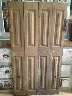 TWO bi-fold raised panel antique wood shutters,tall interior window shutters, architechtural salvage,taupe and aqua,chippy paint,SOLID