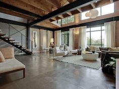 Contemporary Loft - Talk about spacious! I love the contrast between the industrial and woody, cabin-like themes.