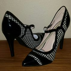 Black n White checkered heels 4 inch heels by Beauty Heel. Has strap for added comfort and security. Brand new, still has paper protections attached! Beauty Heel Shoes Heels