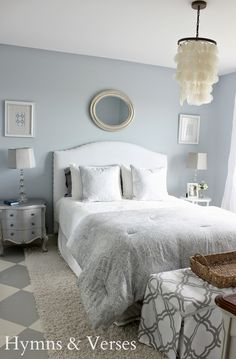lovely bedroom, she has a big mirror framed with barn wood