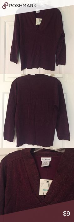 NWT George XL Glitter Sweater Top NWT George sweater. Size: XL. Stretchy!! 53% silk, 26% cotton, 10% polyester, and 5% metallic. 3/4 sleeve. Pretty purple glitter fabric. Length: 22. George Sweaters V-Necks