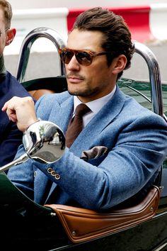 Classic blue jacket, brown tie and retro sunglasses. David Gandy Style