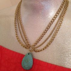 Brushed Gold & Light turquoise necklace Adjustable 17-20 inches. Turquoise drop is stone but I don't think it's real turquoise. Chain is a very light colored gold. No wear or damage. Worn once. Boutique Jewelry Necklaces