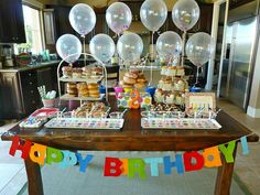 A Donut Party?  Now THIS is my kind of party!  No cake to make! Love the balloons, frame, & cups rolled in sprinkles too.