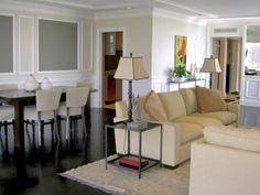 Like these colors--stone grey sofas could work with a neutral paint color on the walls and neutral rug