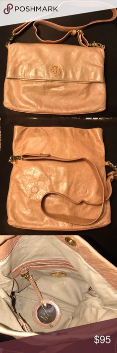 Tory Burch Crossbody The Tory Burch Dena Messenger bag in a beautiful blush pink/ tan color. Leather is soft. In great condition. There's a small area inside the bag with pen mark which is not noticeable when using bag. The flaws on the outside are as picture on the bag of the bag, the bottom, and the hardware is a bit scratched. All not noticeable when worn. The strap is in great condition, does not have rips or peeling. Great handy purse. Tory Burch Bags Crossbody Bags