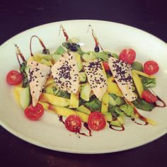 New Specials Every Day! Grilled #salmon #salad with mango and avocado.