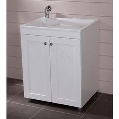 St. Paul - 27 Inch x 32 Inch Laundry Base Cabinet in White - - Home Depot  Canada