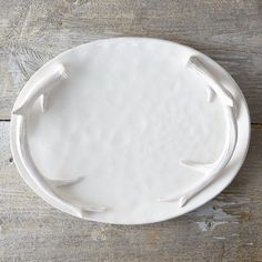 "Two curving antlers serve as the handles of this gleaming, ceramic platter.- Dolomite- Hand wash- Food safe- Antler: 0.75""H, 12.4""L- Imported0.8""H, 11.75""W, 15.25""L"