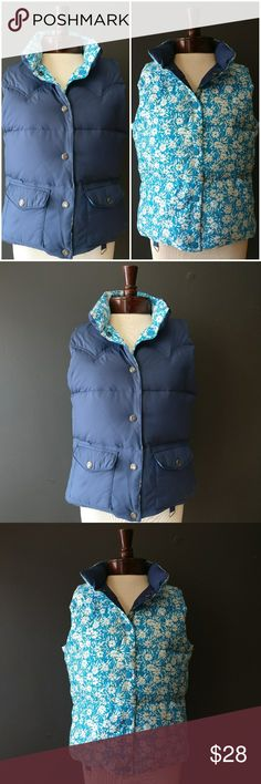 American Eagle Reversible Navy Floral Down Vest American Eagle Reversible Navy Floral Down Vest Since it's reversible, the tear off size tag is gone, it definitely is a S or M. Super cute and warm! American Eagle Outfitters Jackets & Coats Vests
